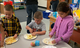 Students peeling apples to the core
