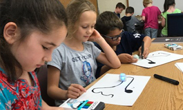 Second-graders coding with Ozbots