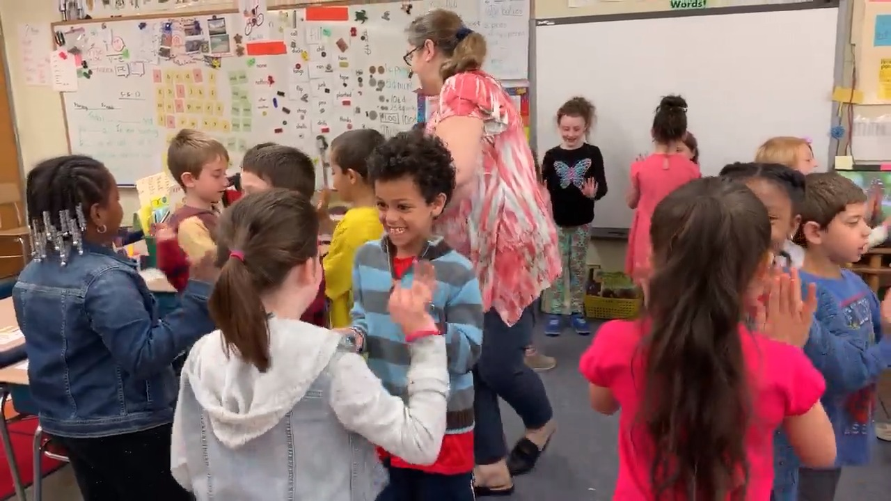 Mrs. Kegler's first-grade class doing a greeting called Boogie On Down.